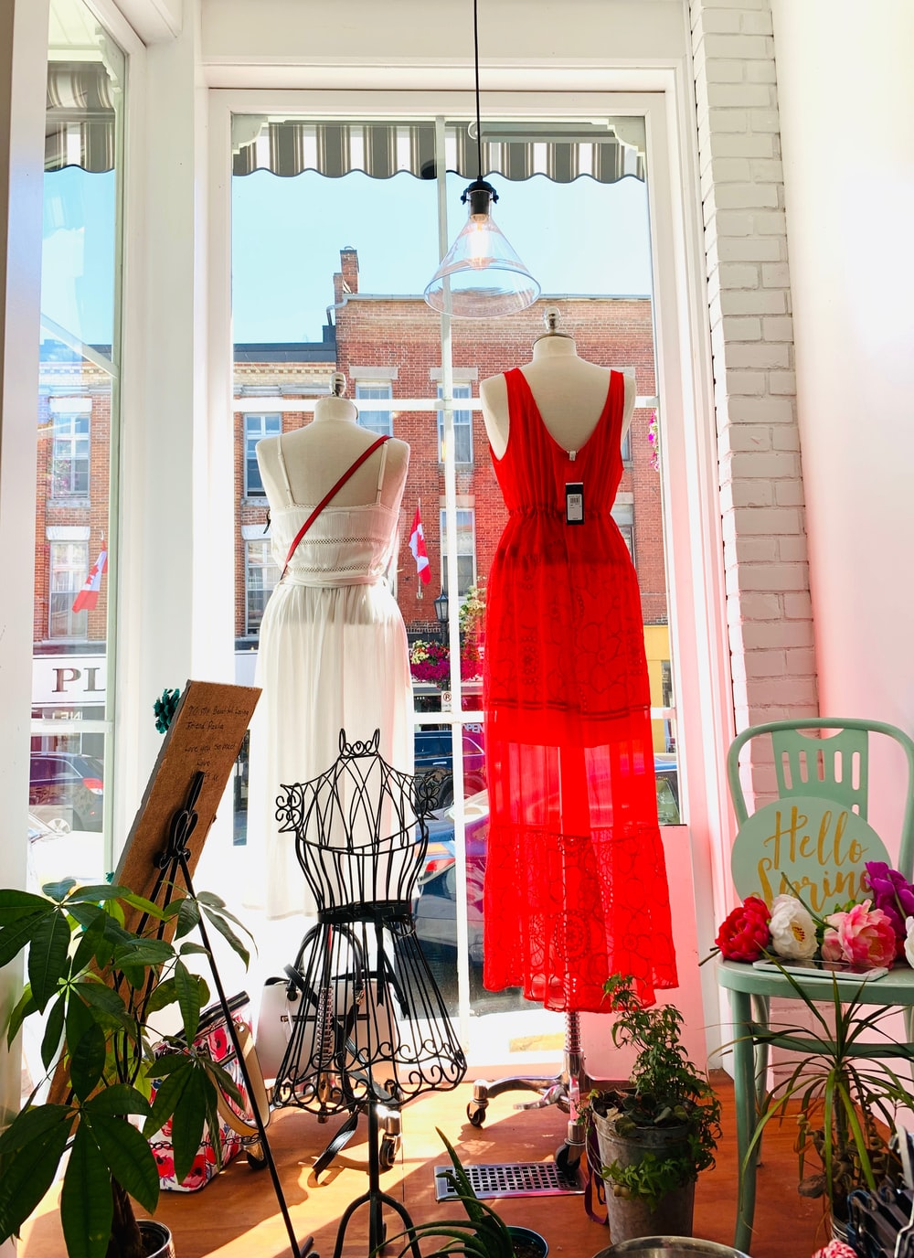 two red and white dress on mannequin