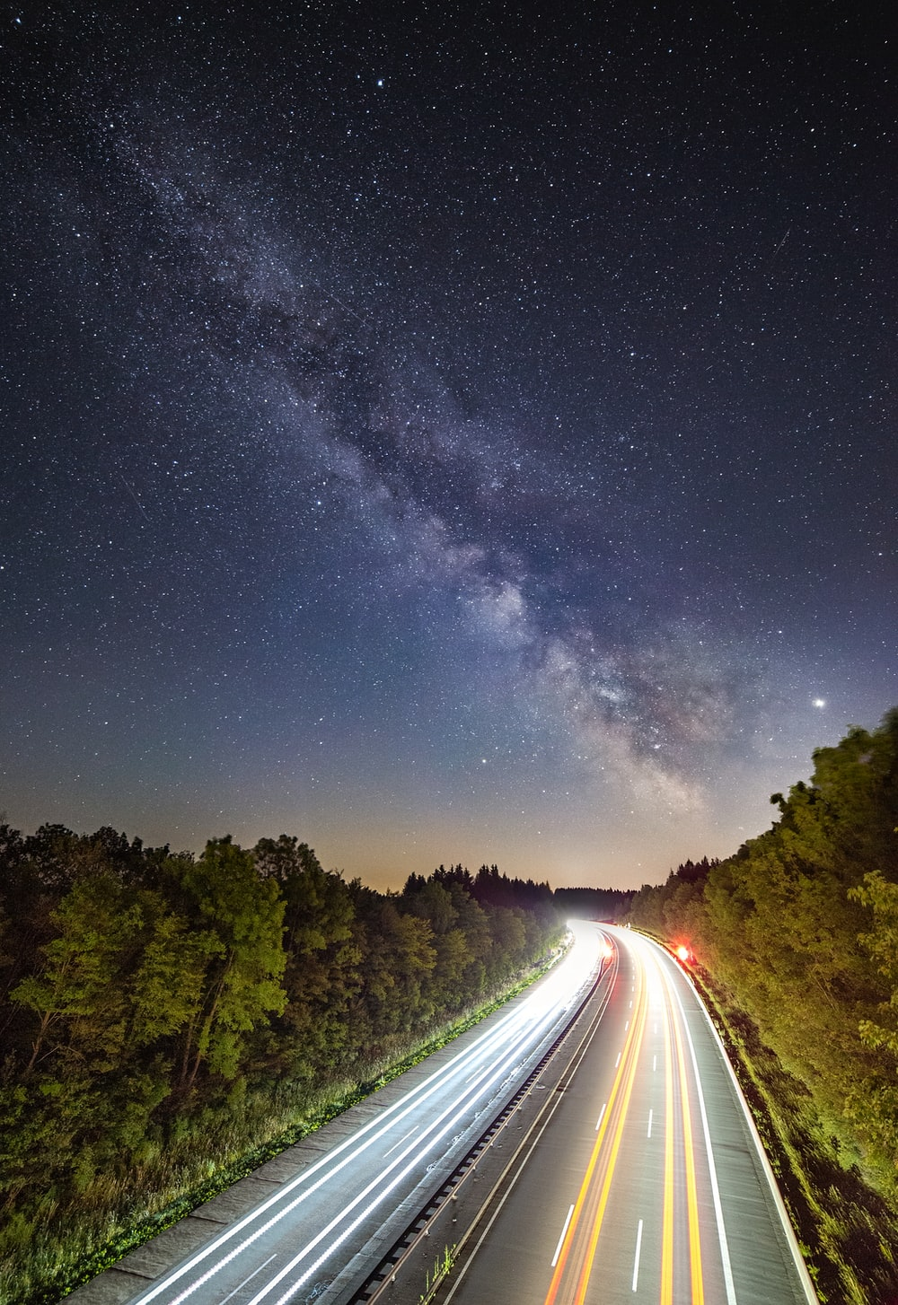 time lapsed photography of vehicles on road during nighttime