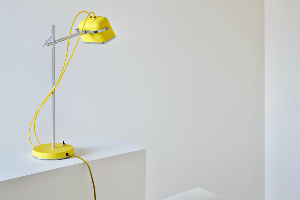 yellow table lamp beside wall