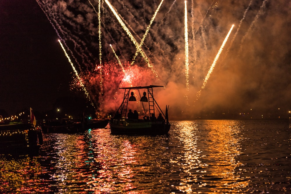 white boat with fireworks