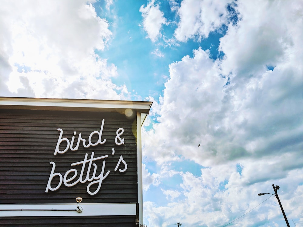 Bird & Betty's signage on building under cloudy sky