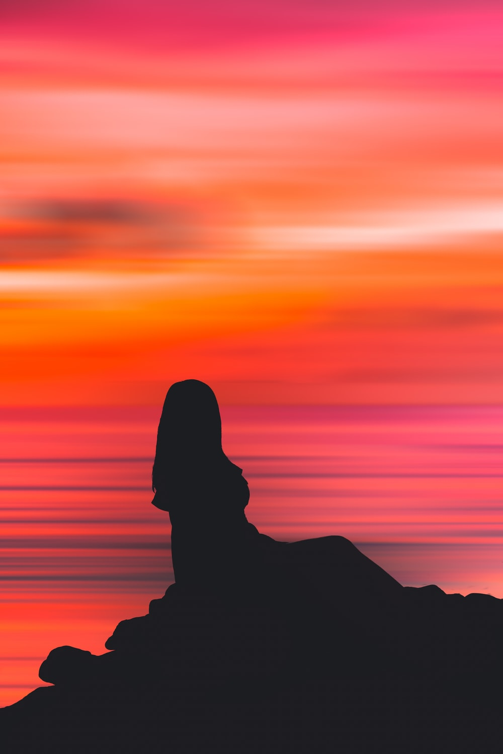 silhouette of person during sunset