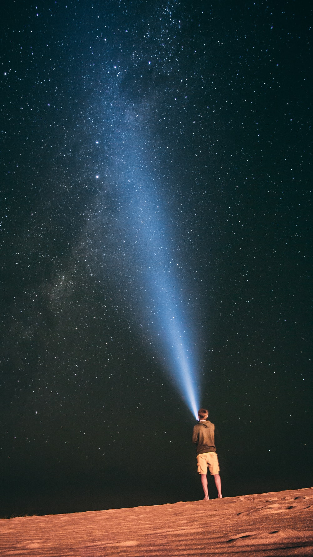 man looking at a starry filled sky