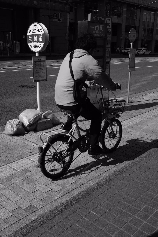 man riding on bicycle