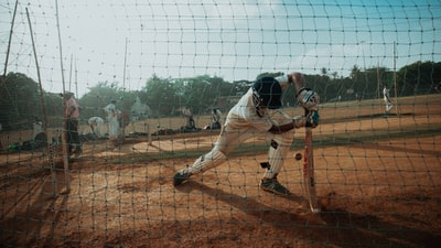 photography of baseball game cricket teams background