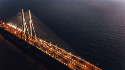 brown and gray concrete bridge during daytime top-view photography mumbai zoom background