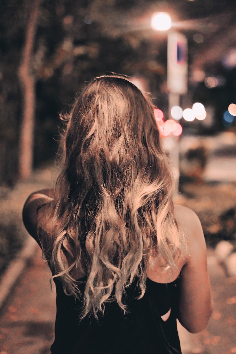 women's black sleeveless top close-up photography