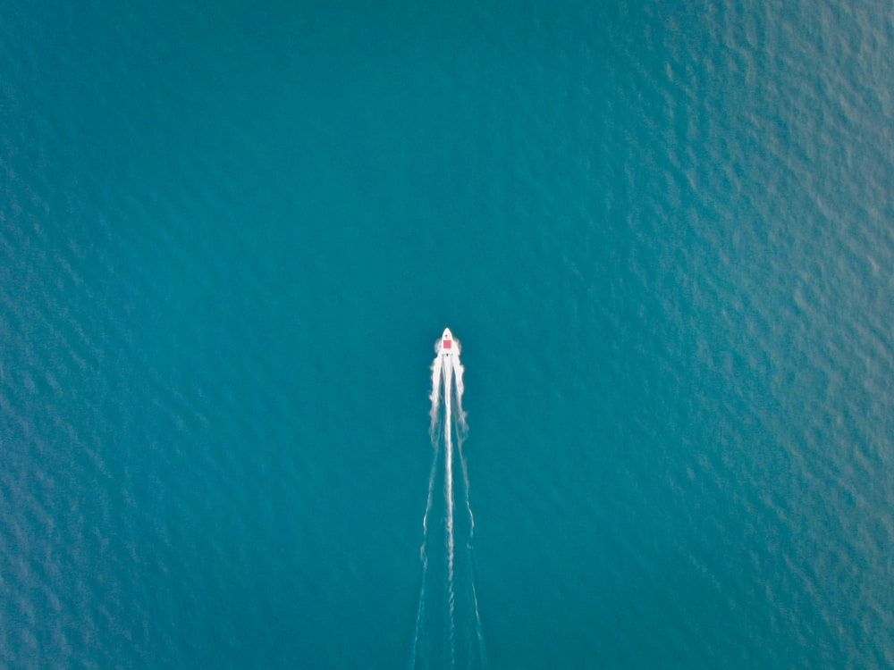 aerial photo of ship on calm body of water
