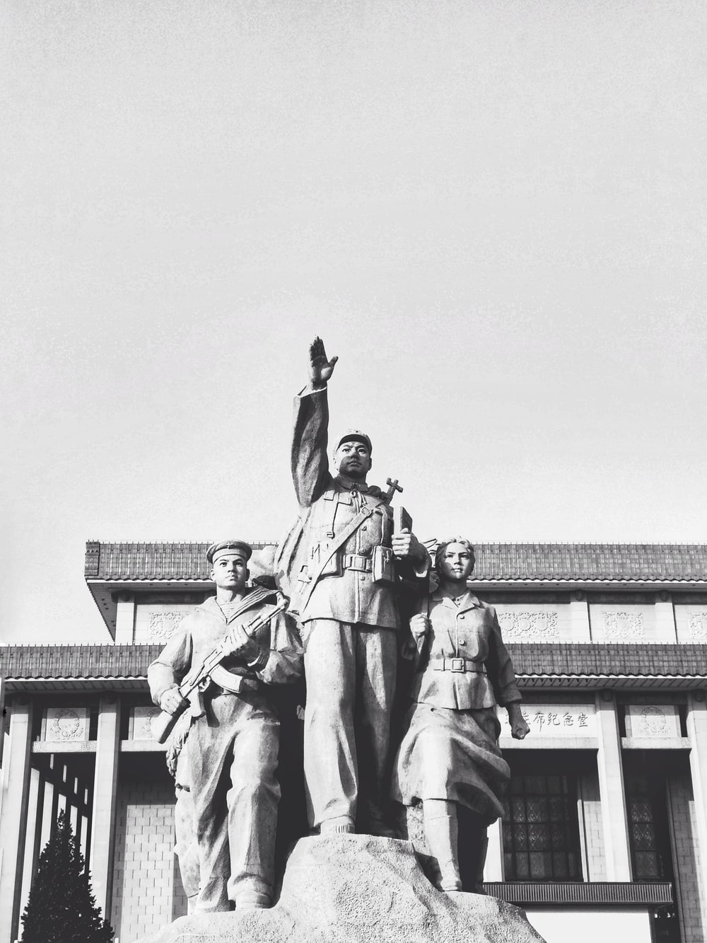 three people standing statue