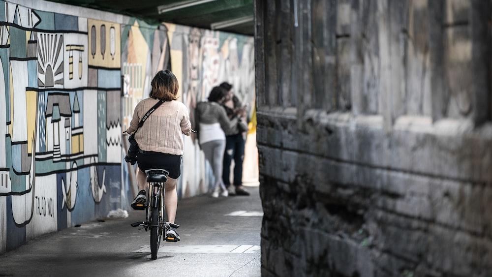 woman wearing pink shirt riding bicycle