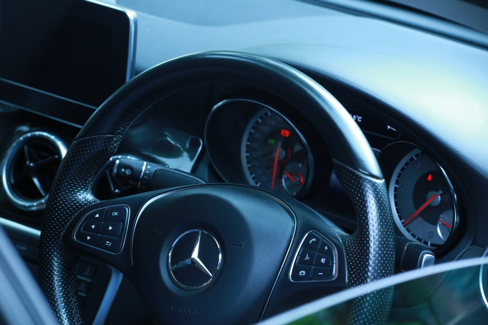 close-up photography of Mercedes-Benz steering wheel