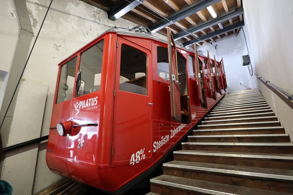 red staircase train with open doors