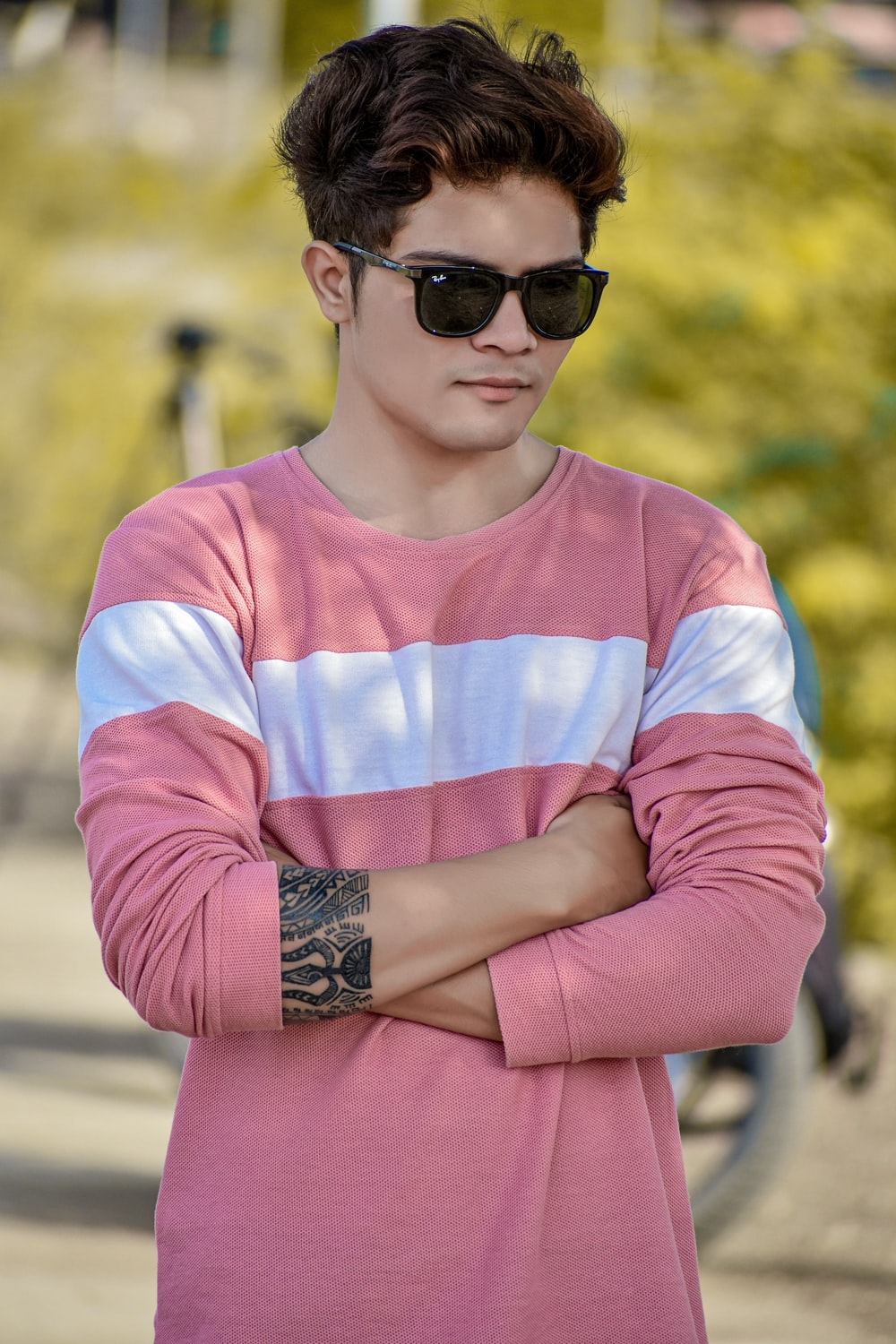 person wearing pink and white shirt