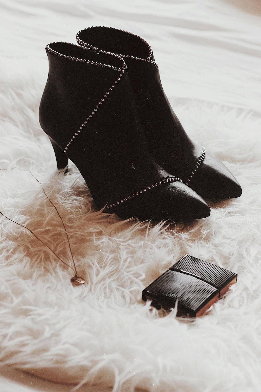 pair of black heeled booties