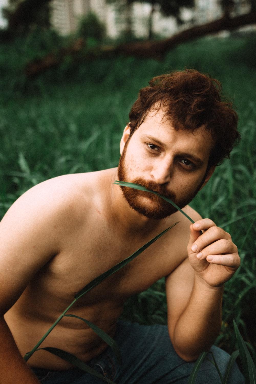 man on grass field
