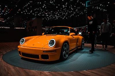orange porsche 959 porsche zoom background