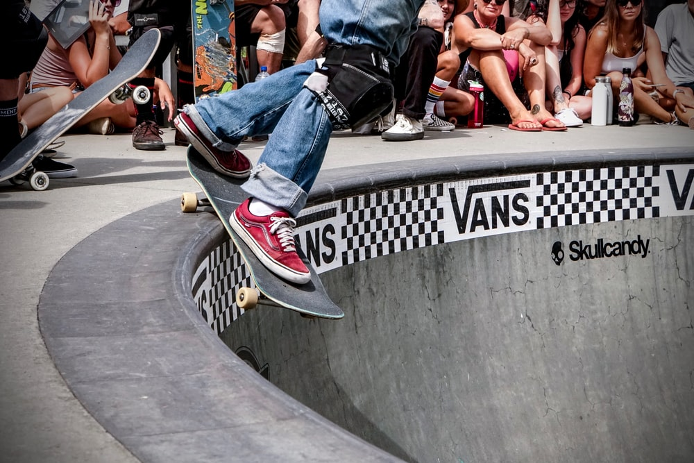 man playing skateboard on skateboard arena