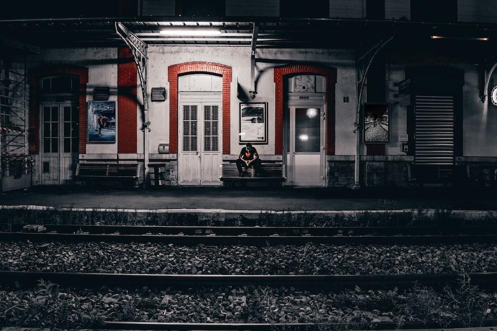 man sitting near wall
