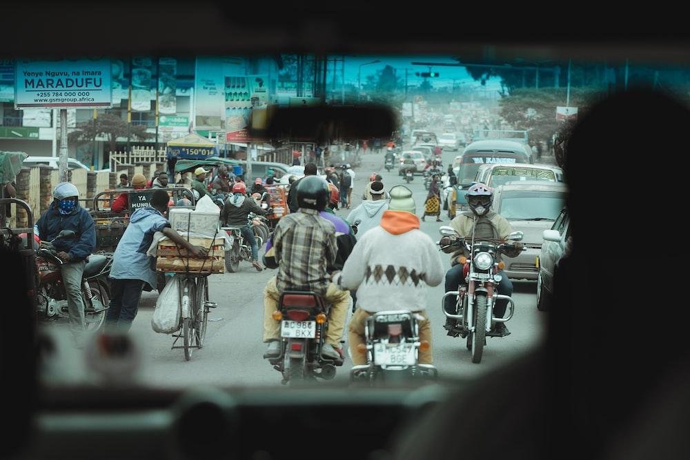 people in motorcycles on road