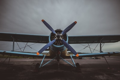 blue biplane during daytime aircraft teams background