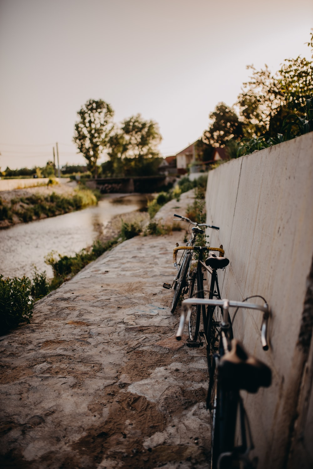 bicycle parked beside wall