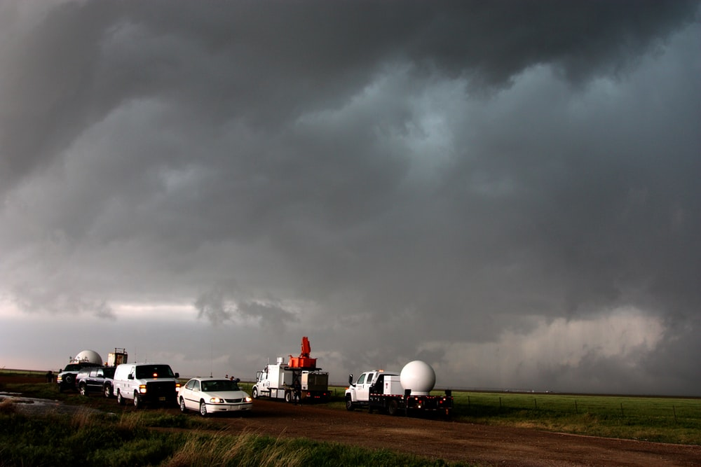 A fleet of VORTEX2 vehicles tracks a supercell thunderstorm near Dumas. The blue-green color in the cloud is associated with large hail.