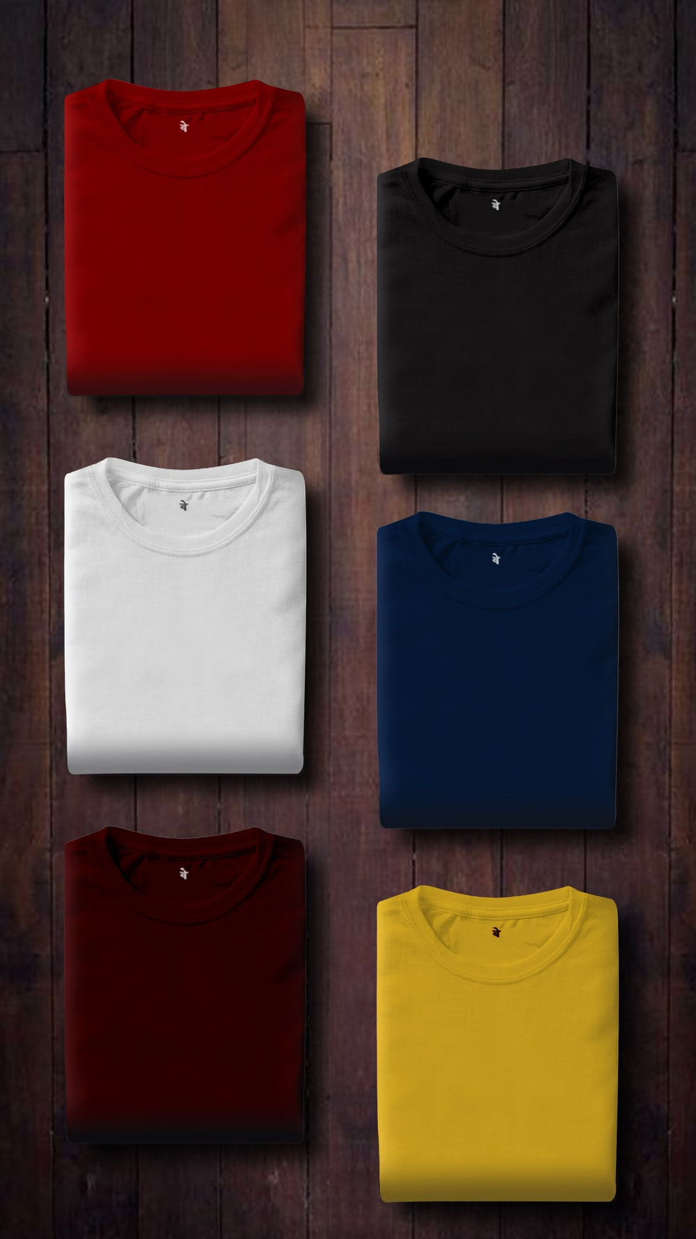 assorted color folded shirts on wooden panel