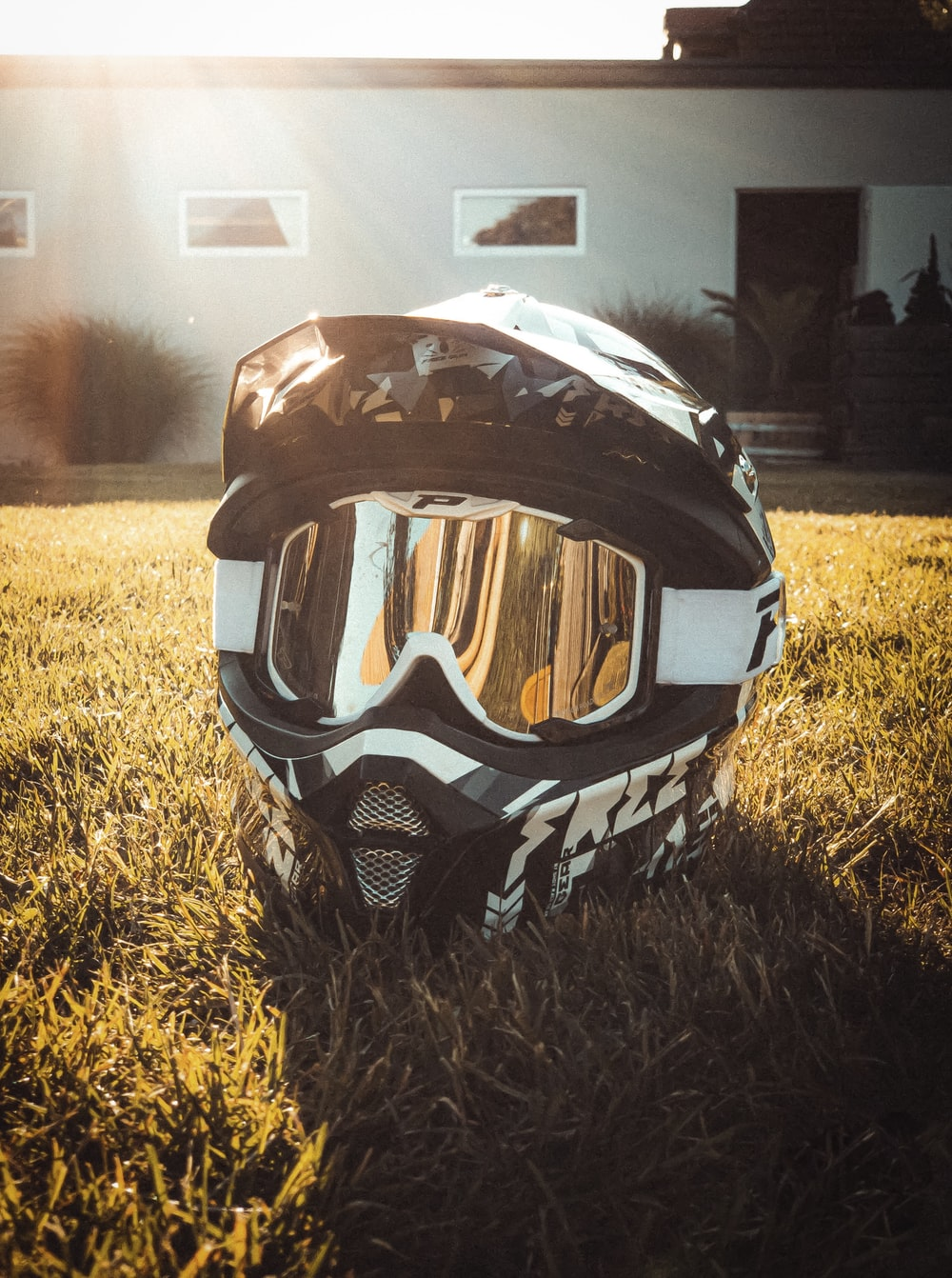 black and gray helmet on grass during daytime