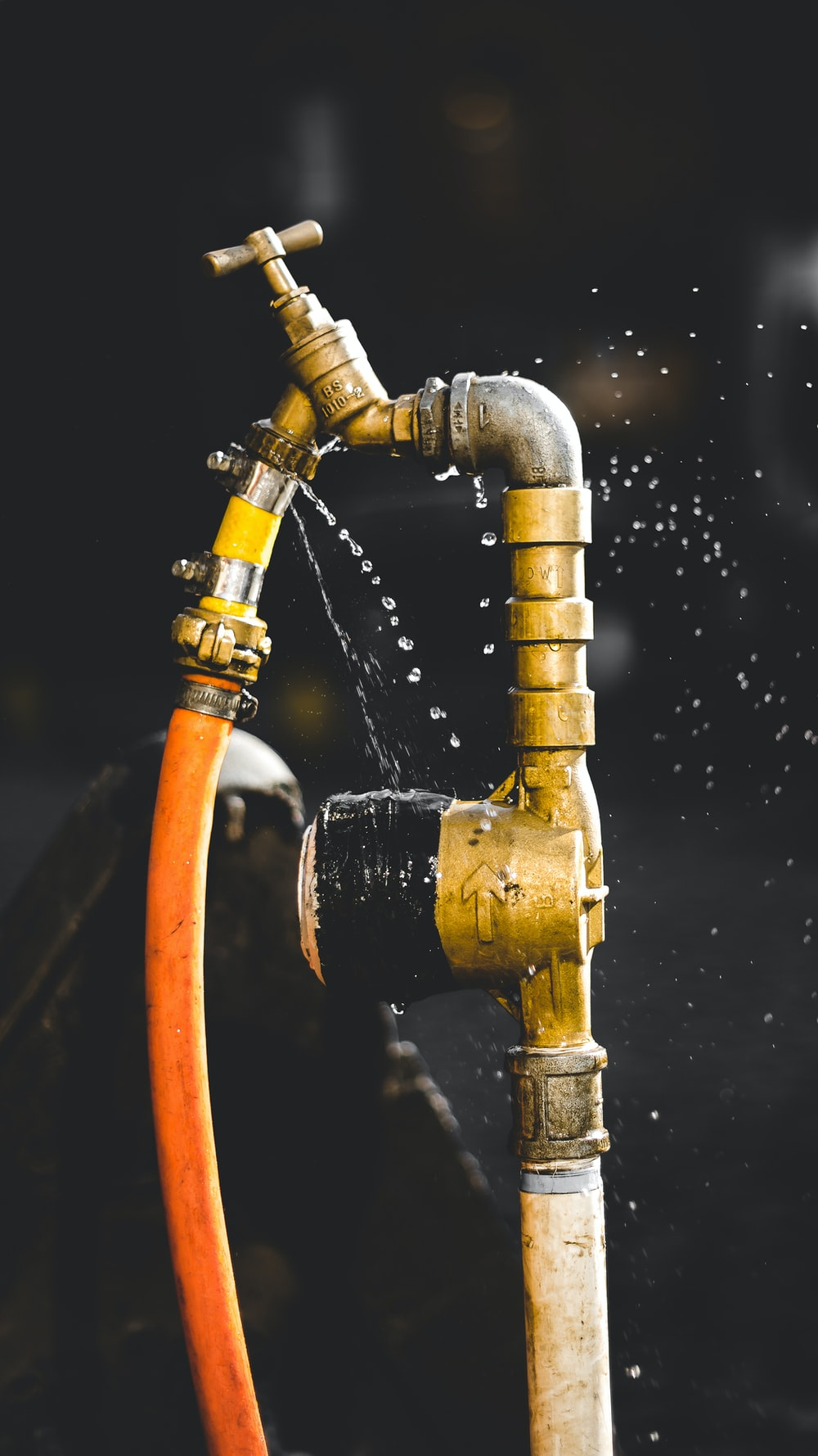 gold-colored faucet close-up photography