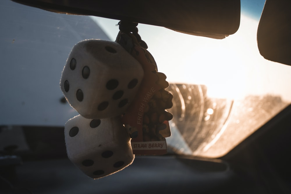 two dice in vehicle