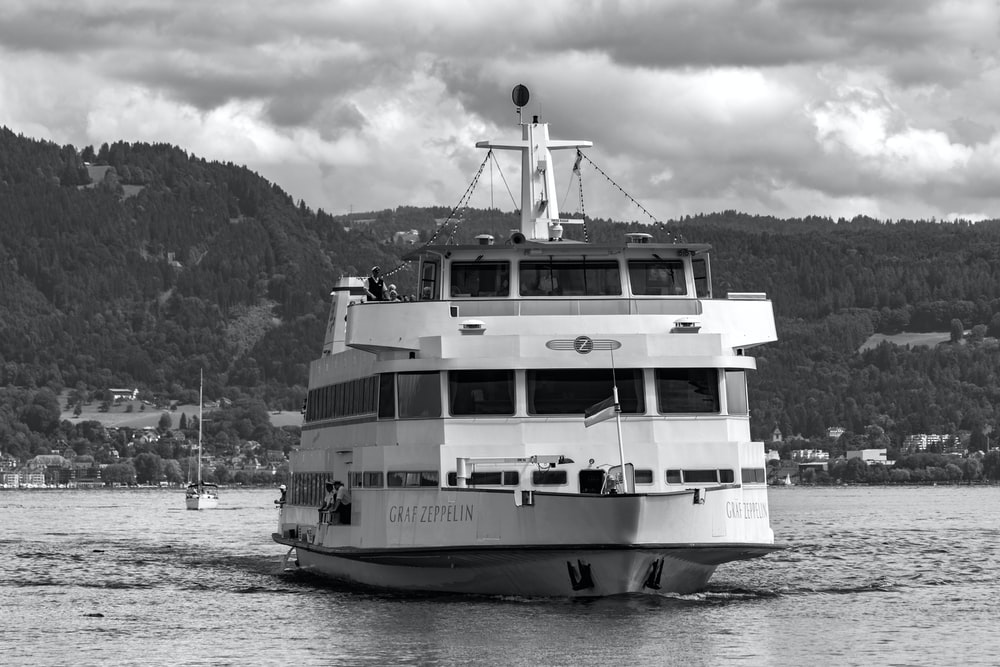 grayscale photo of cruise ship on body of water