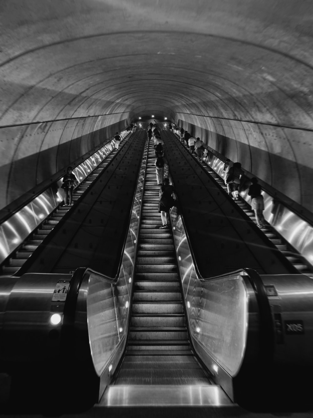 grayscale photography of escalators with no people