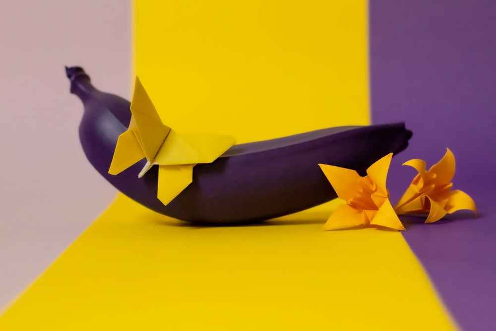 black banana and yellow papers