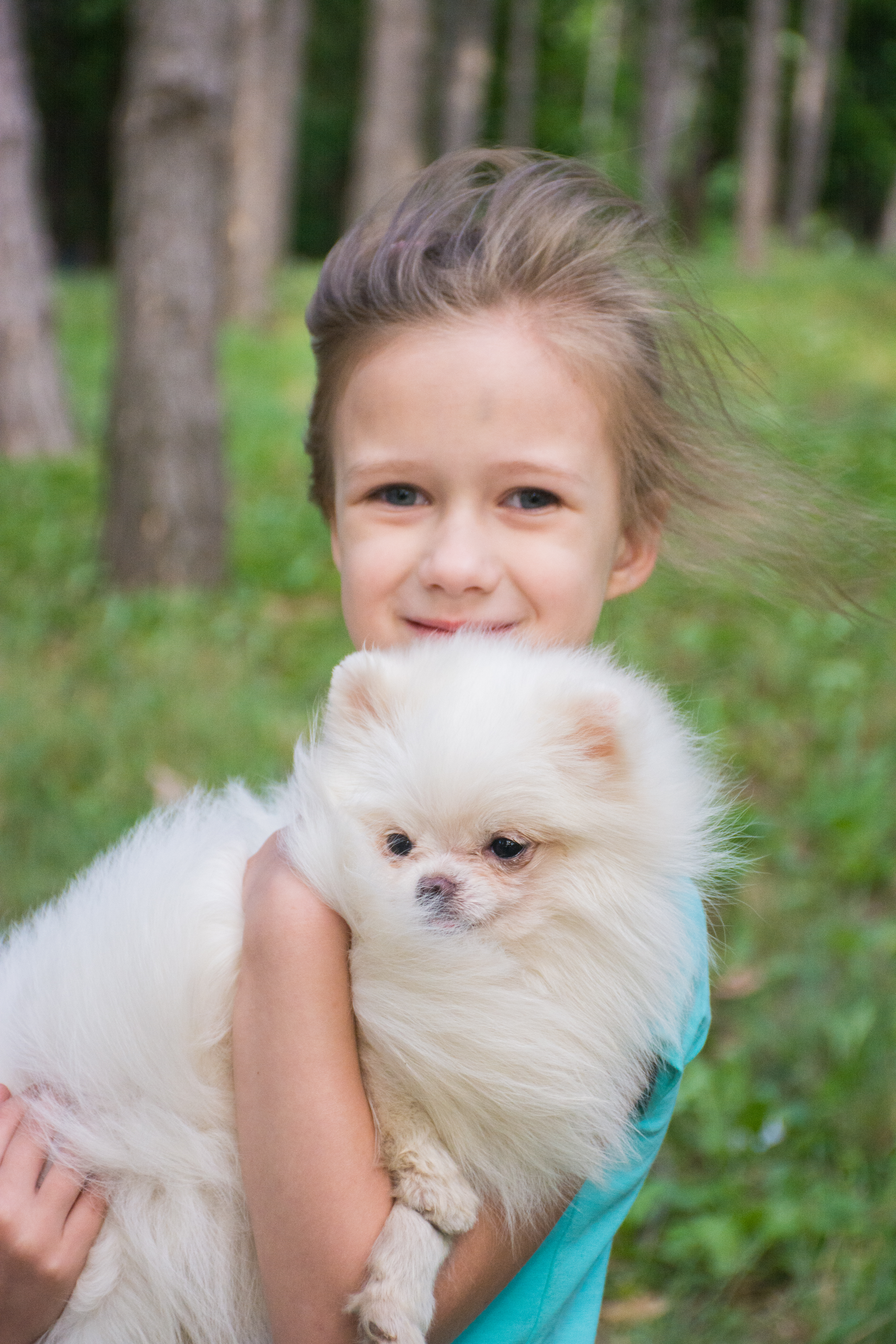 selective focus photography of boy carrying dog