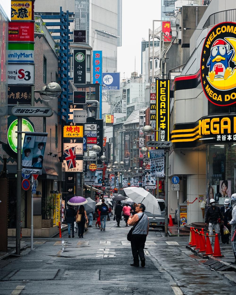 people walking near high-rise buildings during daytime