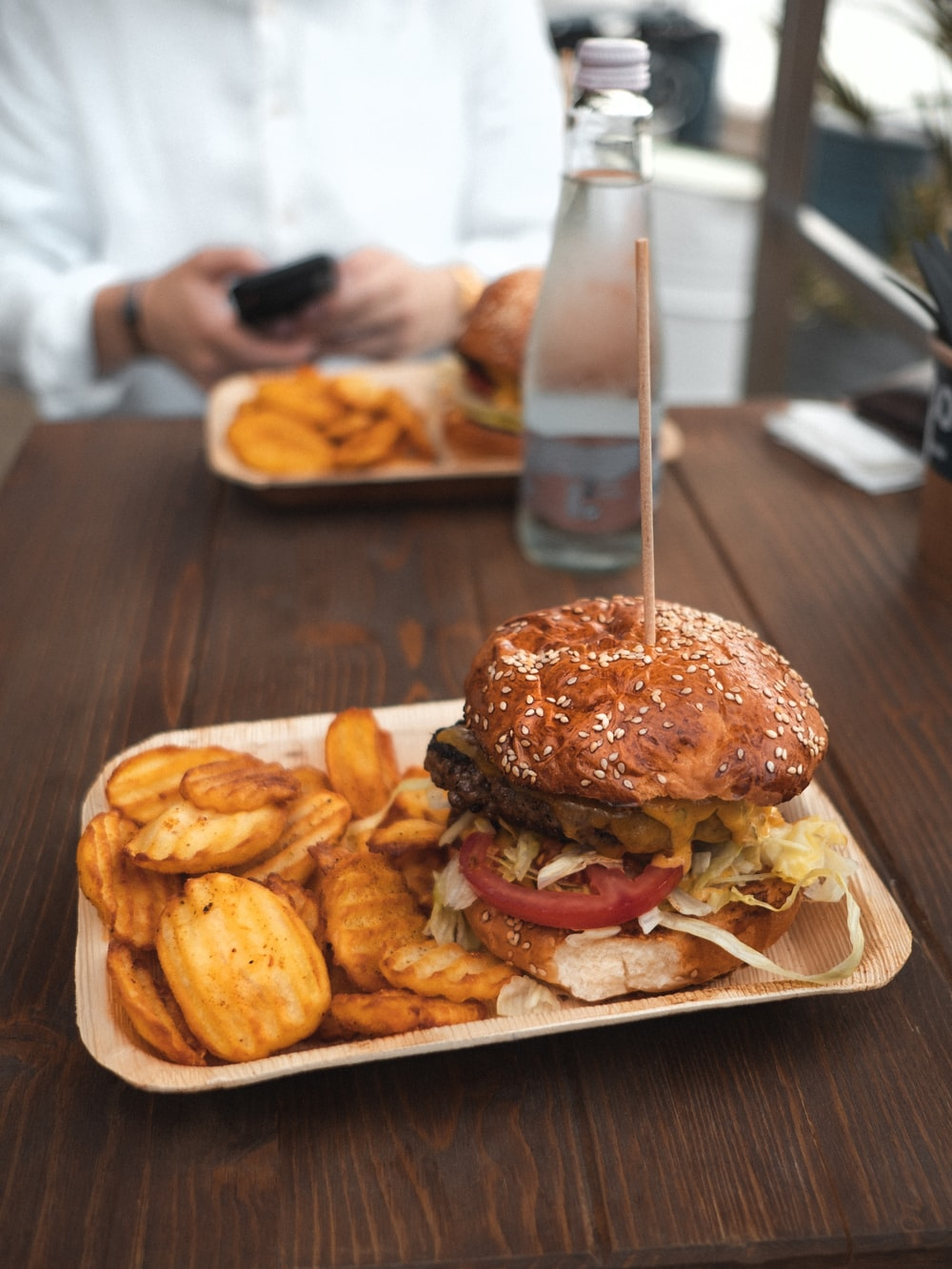 tasty burger and potato fries on plate