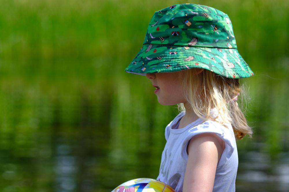 girl wearing green bucket hat