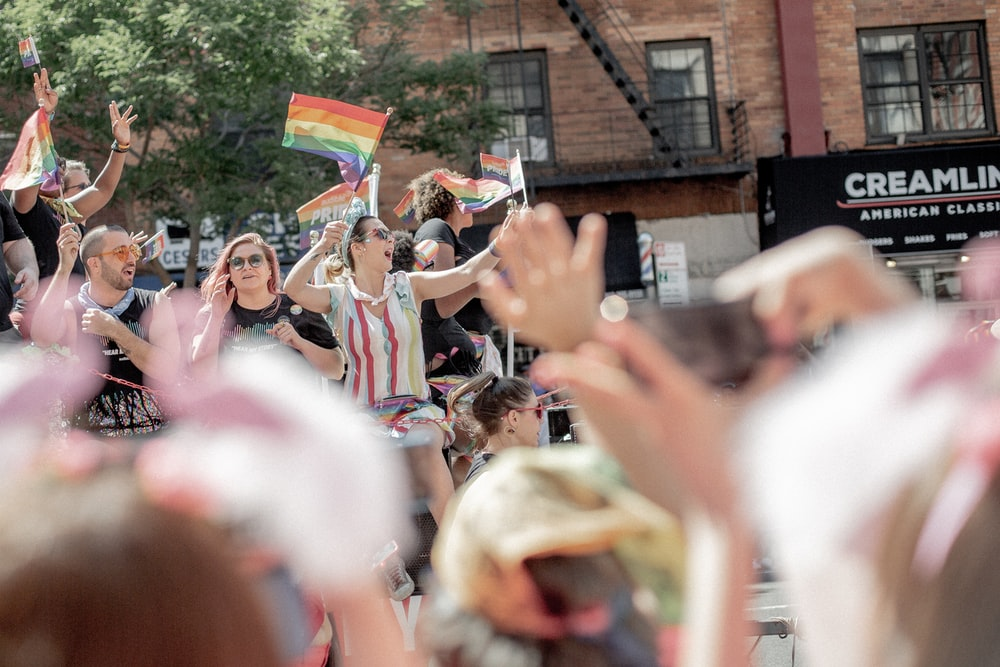 LGBT community rallying on street near buildings