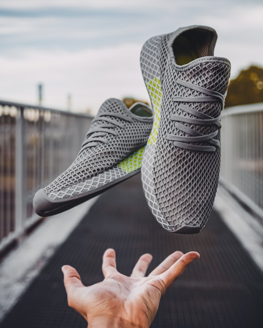 pair of gray running shoes