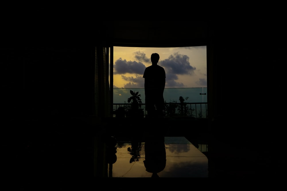 silhouette of person standing