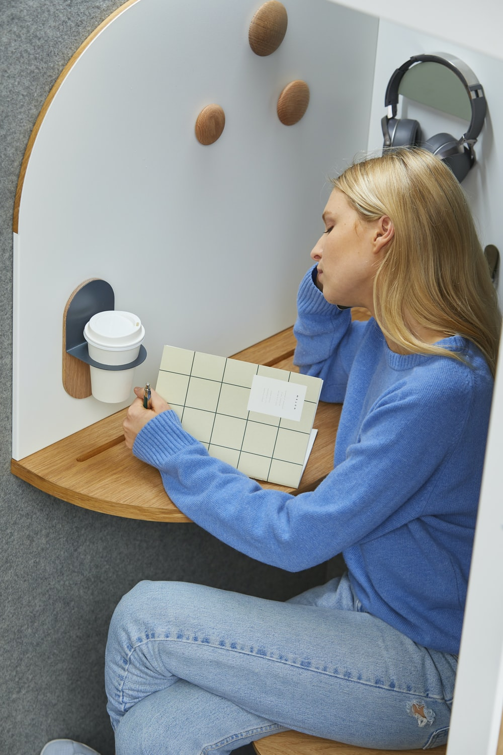 woman in a white and brown cubicle