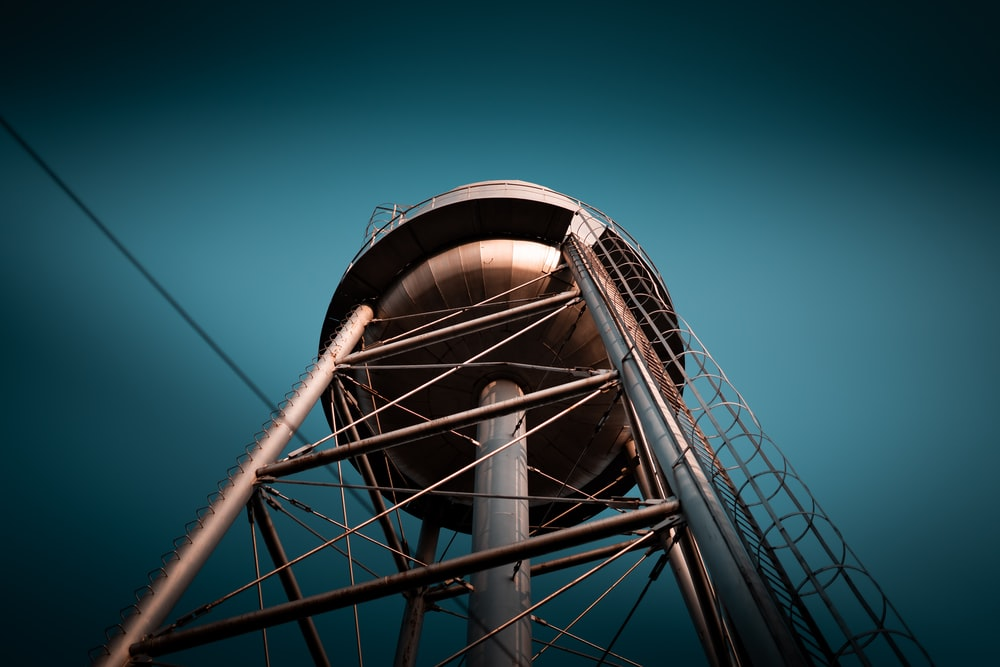 low-angle photography of water tank