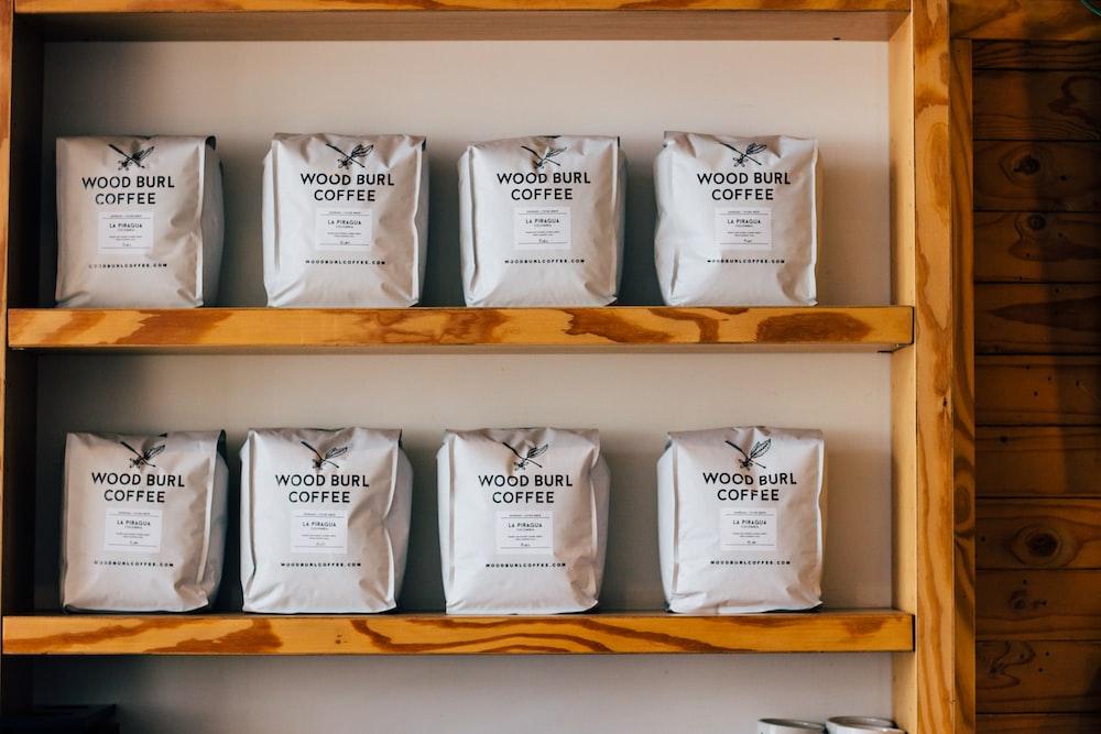 wood burl coffee packs on wooden shelf