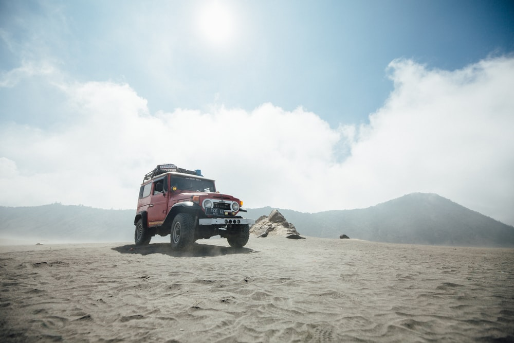 low-angle photography of a wrangler vehicle in desert
