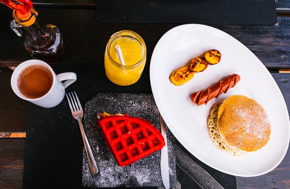 sausage between fried banana and pancake