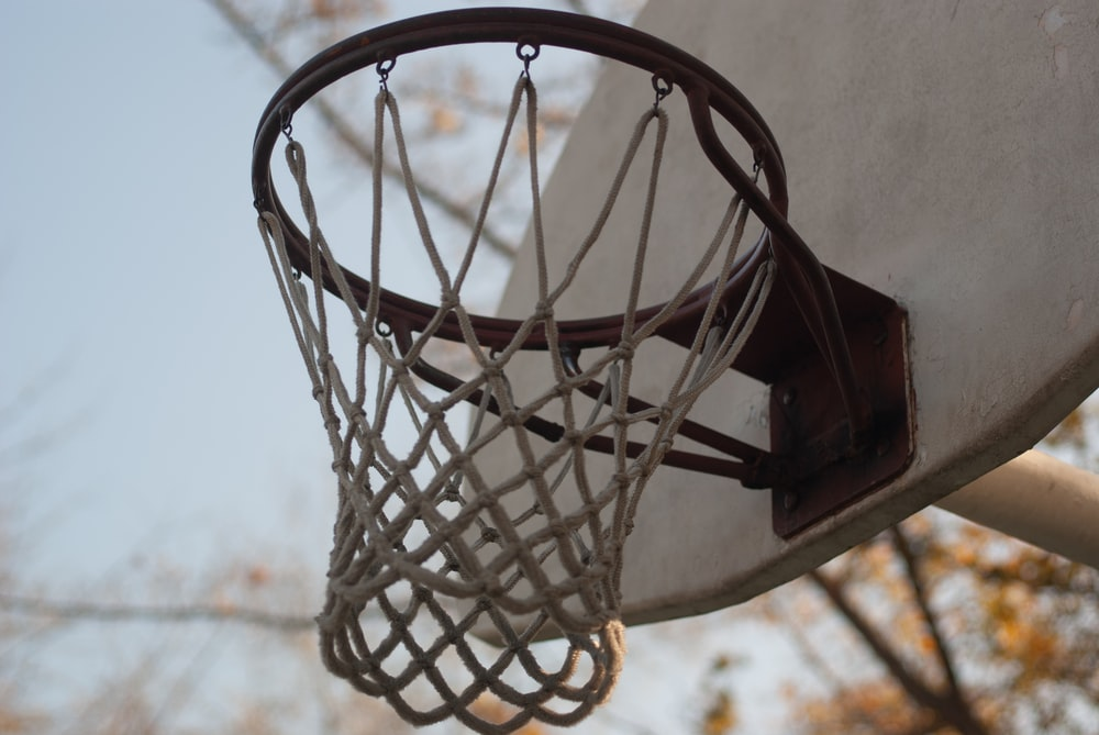 white painted board basketball ring