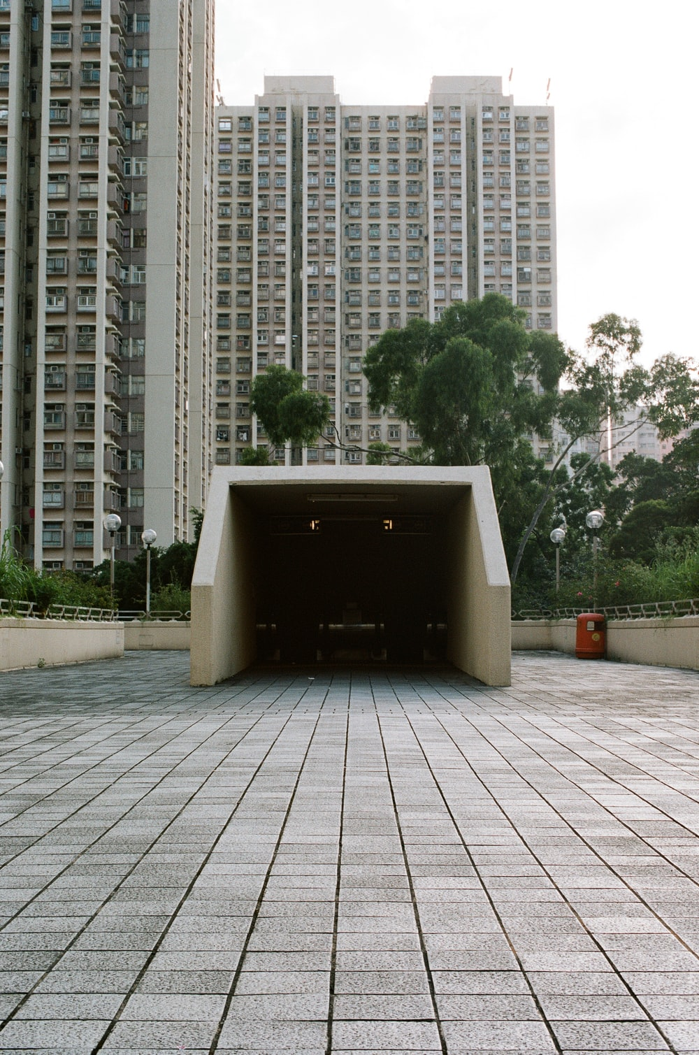 white concrete walkway arch near buildings