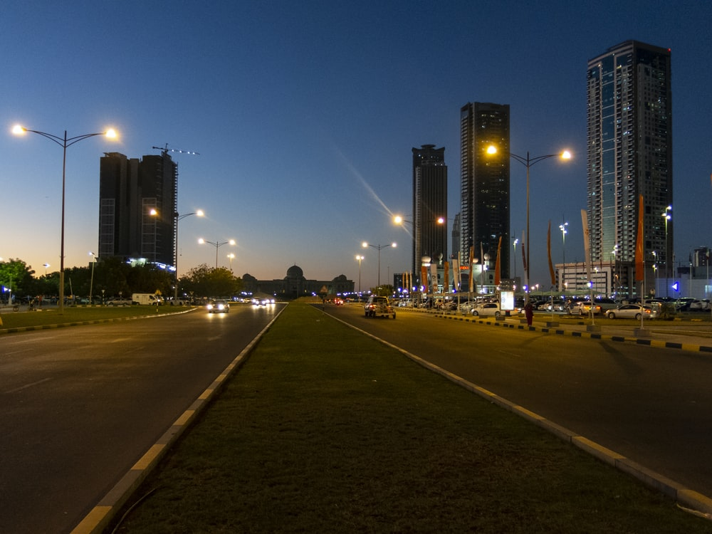 concrete road between buildings at nighttime