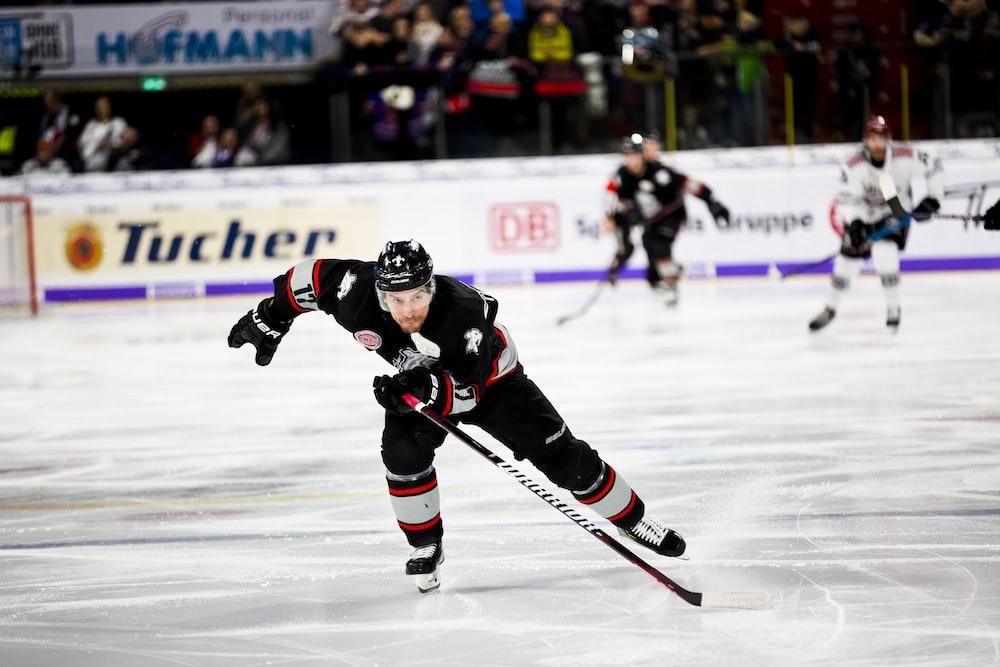 ice hockey player sliding on ice rink