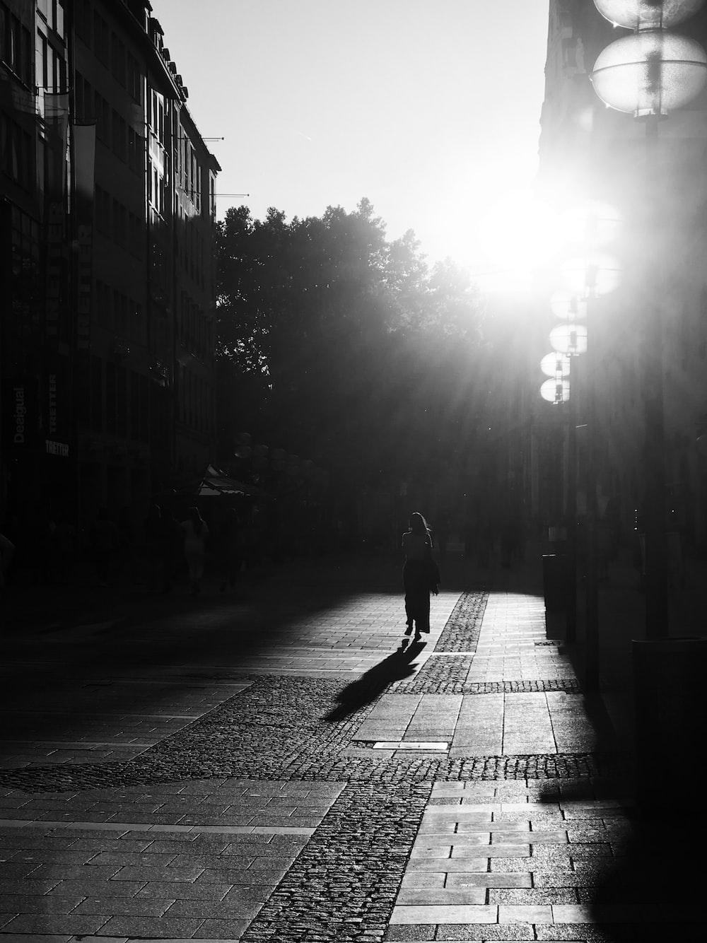 woman walking on alley
